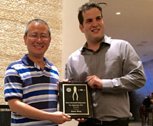 2015 Winner Jason Wang receives Award from W-JETS Executive Director Adrien Livingston